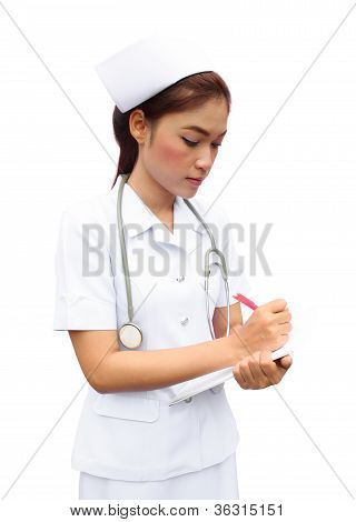 Asian Female Nurse Writing Medical Report
