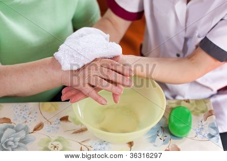 Nurse Washes Old Patient's Hands