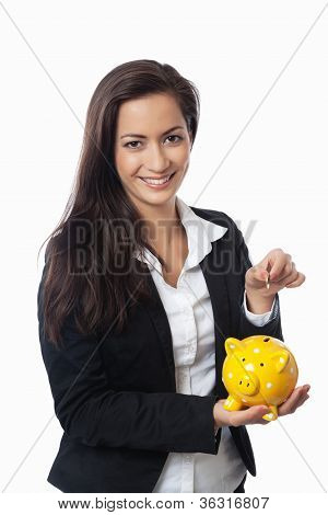 Asian Businesswoman Putting Money Into Piggy Bank