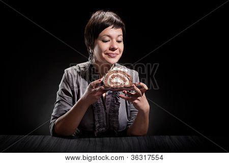 Elegant Girl Eating A Chocolate Cake