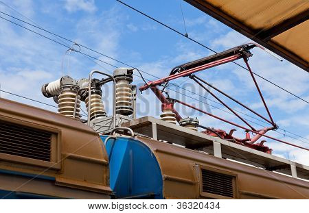 Railroad Overhead Lines Against Blue Sky.