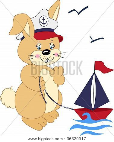 Sailor rabbit playing with a boat