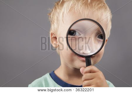 Young Boy Holding Magnifying Glass