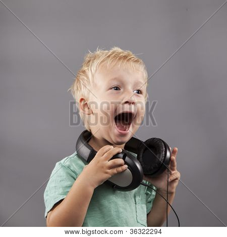 Young Boy With Headphones Sings