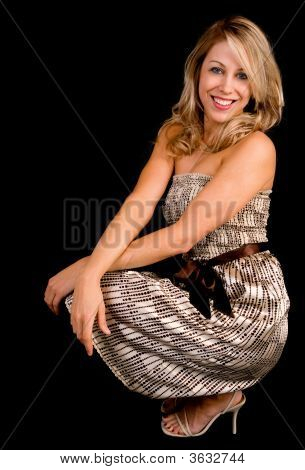 Beautiful Smiling Blonde Lady In A Beige Dress