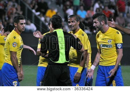 Soccer players protesting against referee