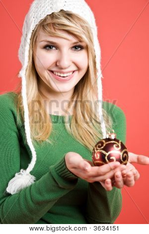 Caucasian Girl With Christmas Ornament