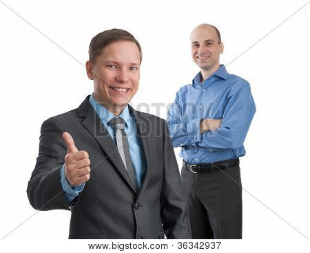 Smiling Young Business Man With Thumbs Up Gesture