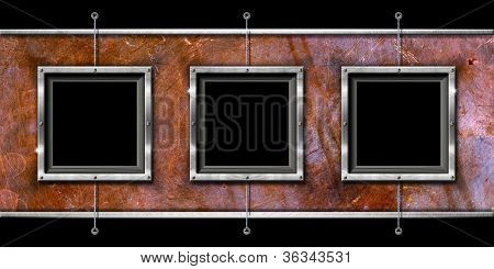 Three Metal Frames On A Grunge Wall
