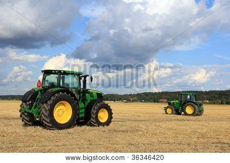 Two John Deere Tractors On Display