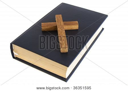 wood cross and blue bible