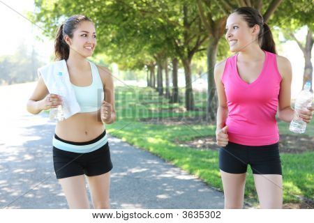 Pretty Sisters Jogging In Park