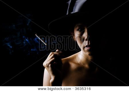 Woman In Shadow Wearing A Black Hat