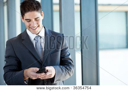 happy businessman reading emails from a smart phone