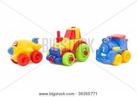 Set From Three Plastic Toys - The Plane, A Tractor And A Steam Locomotive.