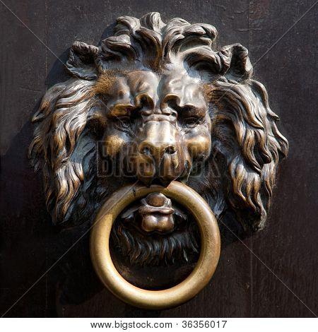 Antique lion's head doorknocker in Aachen, Germany