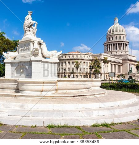 Beautiful old marble fountain with the Capitol of Havana in the background