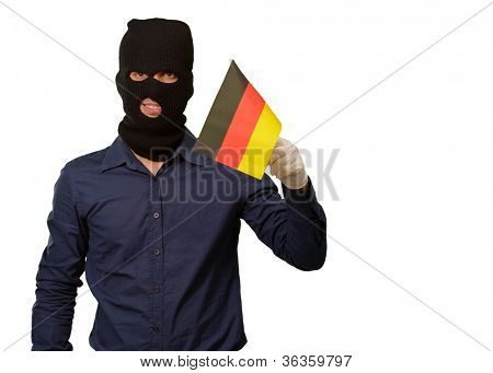 Man wearing robber mask and holding flag on white background