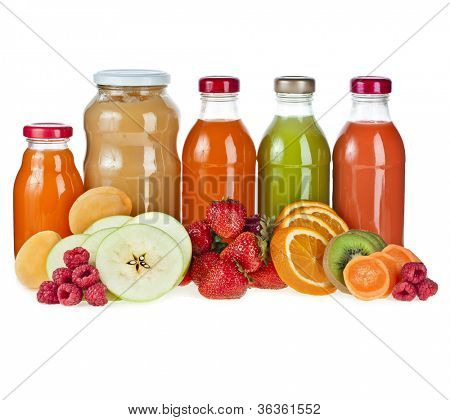 Colorful Bottles juice and puree with fresh berries and fruits isolated on white