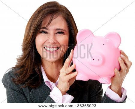 Happy businesswoman with her savings in a piggybank - isolated