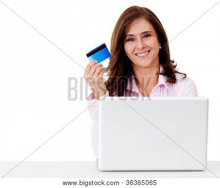 Happy woman shopping online paying with credit card - isolated over a white background
