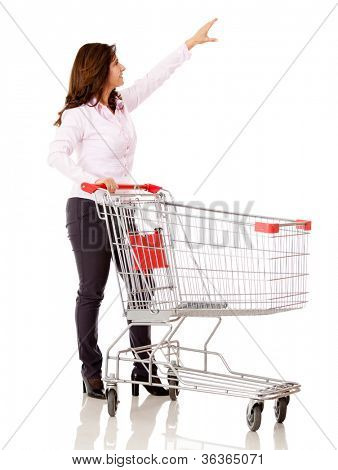 Woman with a shopping cart reaching for something - isolated over white