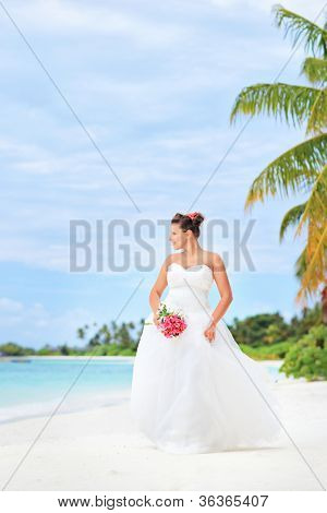 Young bride on a beach in Kuredu resort, Maldives island, Lhaviyani atoll