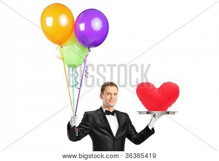A butler holding balloons and a tray with a heart shape object isolated on white