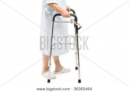 An old patient using a walker isolated against white background
