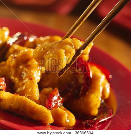 Chinese food - Eating General Tso's chicken with chopsticks.