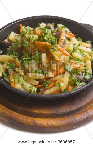 Chicken Baked With Potatoes And Carrot Strewed With Parsley