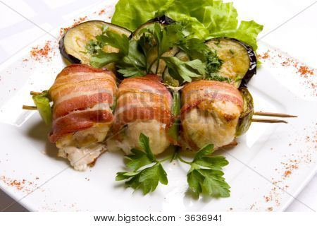 Grilled Chiken Meat Wraped In Bacon Stringed On Wooden Brochette
