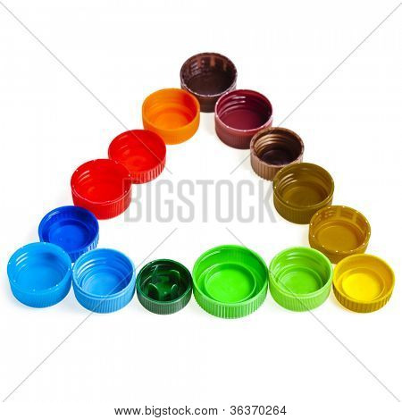 colorful plastic bottle caps , recycle symbol isolated on white