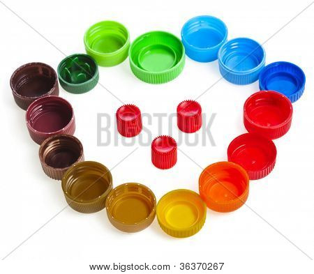 colorful plastic bottle caps isolated on white