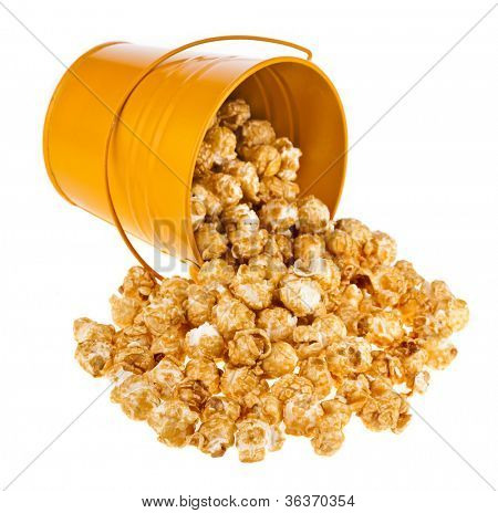 popcorn with caramel in a bucket isolated on white