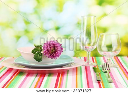 Table setting on bright background close-up