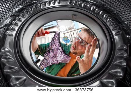 Repair of washing machine. A man found a women's panties