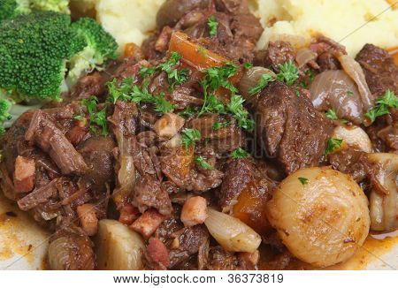 Beef bourguignon stew, a classic French dish with shallots, lardons and carrots.