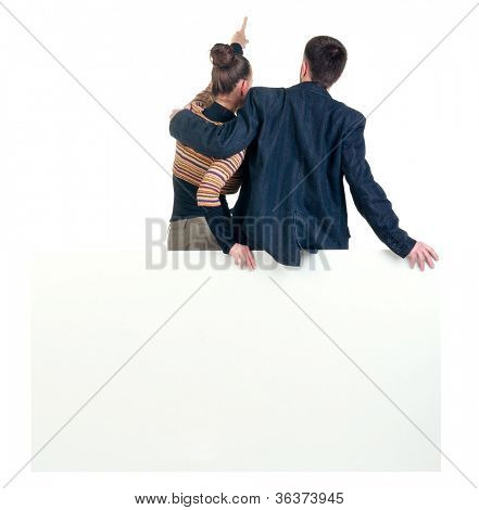 Back view of pointing business team with  empty billboard. young couple (man and woman). girl and guy in suit. Rear view people collection. backside view person. Isolated over white background