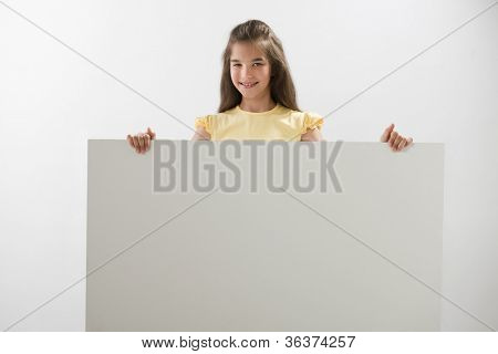 Little girl holding a blank sign; you can add your own text