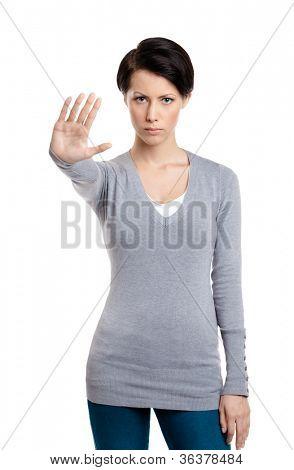 Smart girl shows stop gesture, isolated on white