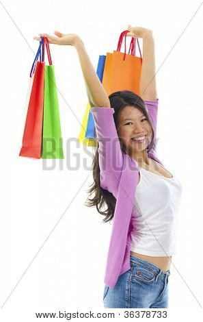Happy shopper holding shopping bag high over white background