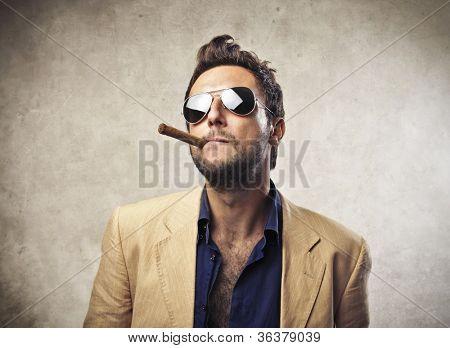 Elegant young man smoking a cigar