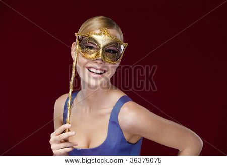 Pretty lady with masquerade masque, isolated on purple