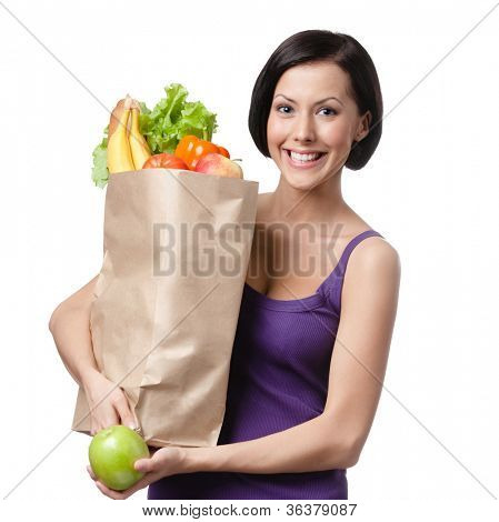 Pretty young woman with the packet full of different healthy nutrition, isolated, white background