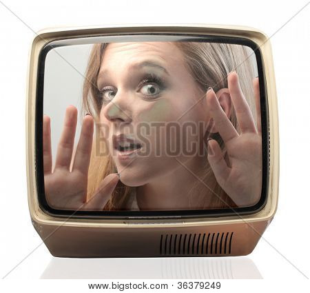 Young woman trapped in a television screen