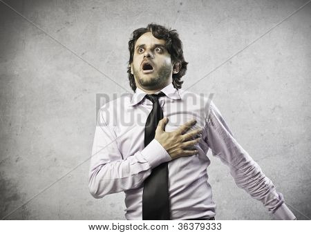 Businessman having a heart attack