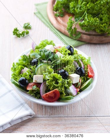 Mediterranean style salad with feta and olives