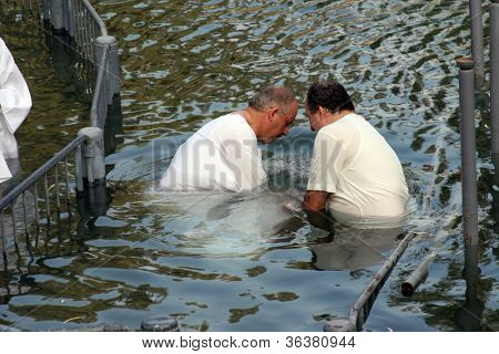 YARDENIT , ISRAEL - SEPTEMBER 30: Baptismal site at Jordan river shore. Baptism of pilgrims  in Yardenit, Israel on September 30, 2006.