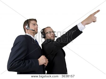 Handsome Businessman Pointing In Front